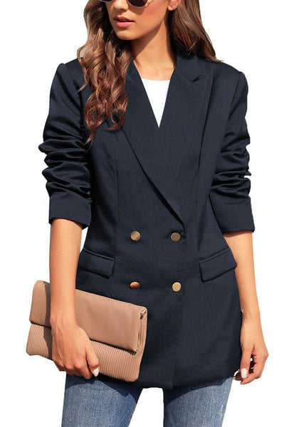 Front view of model wearing navy notch lapel double-breasted side pockets blazer