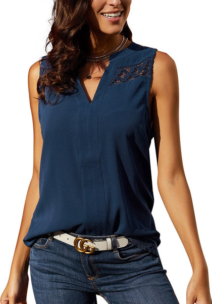 Front view of model wearing navy notched V-neck crochet lace sleeveless top