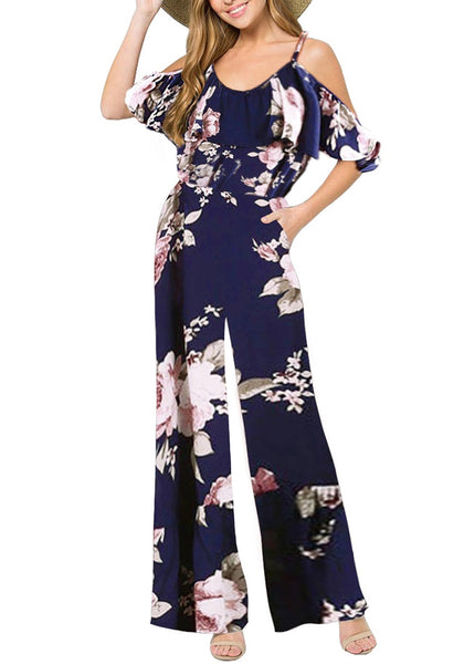 Front view of model wearing navy ruffled cold-shoulder wide-leg floral jumpsuit