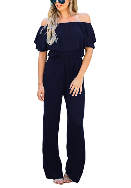 Front view of model wearing navy ruffled off-shoulder jumpsuit