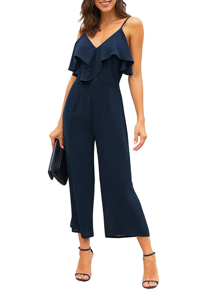 Front view of model wearing navy ruffled spaghetti-strap surplice jumpsuit's