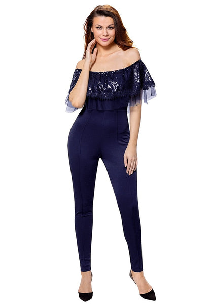Front view of model wearing navy sequin ruffled off-shoulder jumpsuit