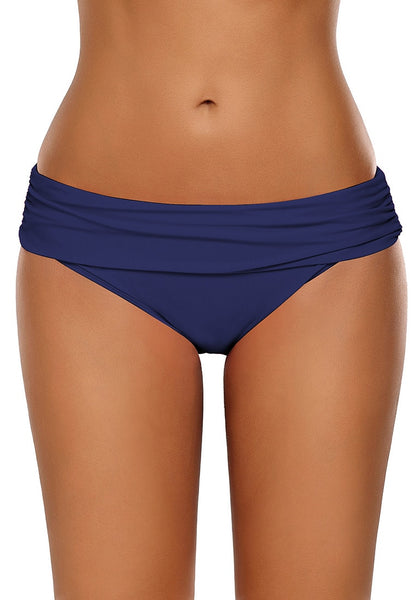 Front view of model wearing navy shirred waistband swim bottom
