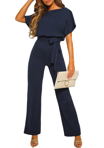Front view of model wearing navy short sleeves keyhole-back belted jumpsuit
