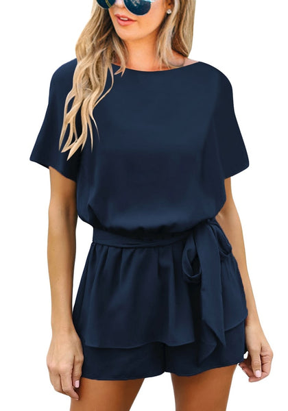 Front view of model wearing navy short sleeves keyhole-back belted romper