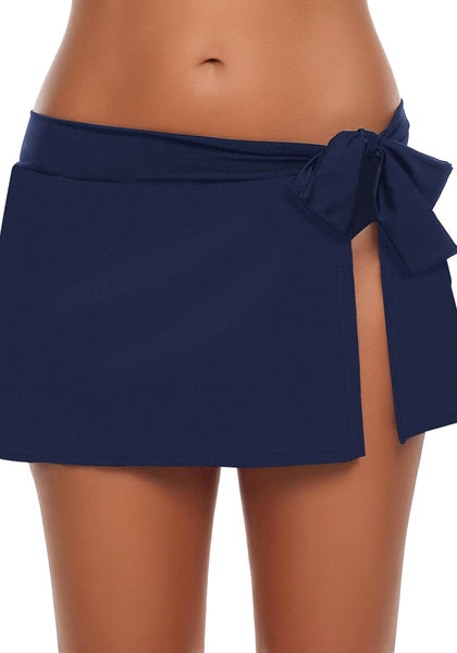 Front view of model wearing navy side slit bowknot swim skirt
