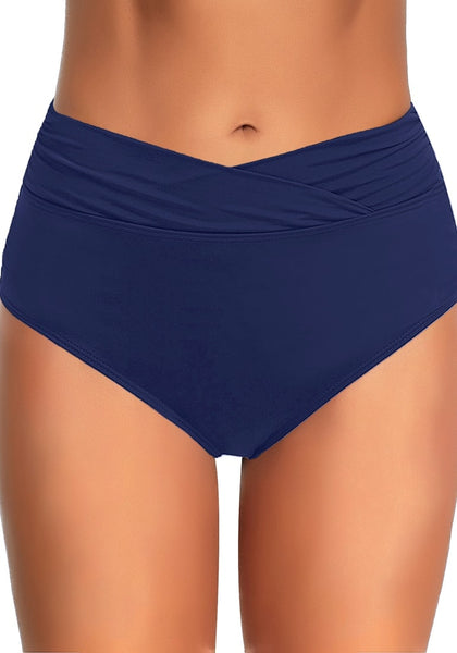 Front view of model wearing navy surplice-waist ruched bikini bottom