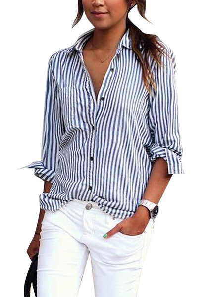 Front view of model wearing navy vertical striped long sleeves button-up top pairing it with white pants