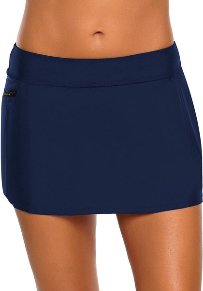 Front view of model wearing navy zipper-pocket waistband skirted bikini bottom