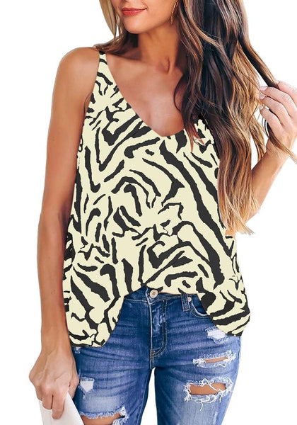 Front view of model wearing off white zebra-print strappy back loose cami top