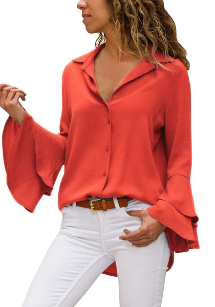 Front view of model wearing orange trumpet sleeves curved hem button-up top