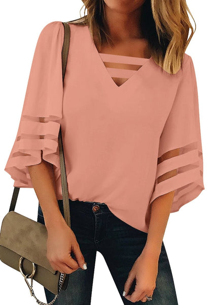 Front view of model wearing pink 34 bell mesh panel sleeves strappy V-neckline loose top