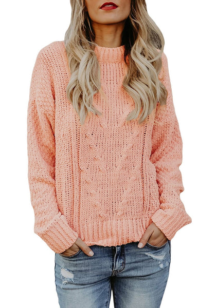 Front view of model wearing pink crew neck velvet cable knit pullover sweater