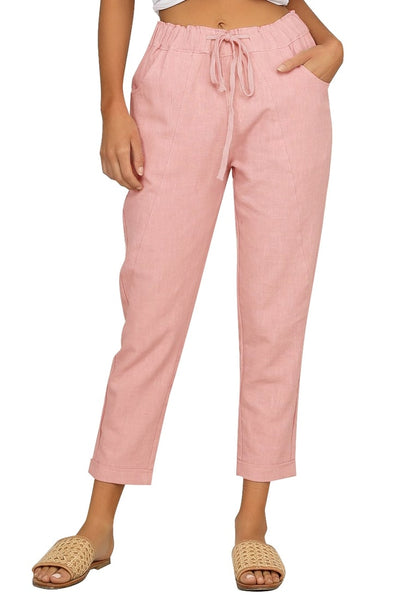 Front view of model wearing pink drawstring-waist rolled-up cropped pants