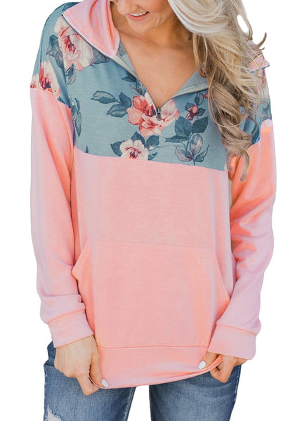 Front view of model wearing pink floral patchwork print half-zip pullover top