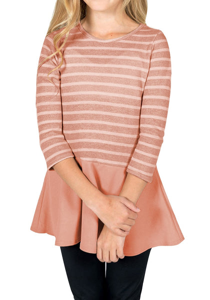 Front view of model wearing pink striped ruffle hem flared girl tunic top