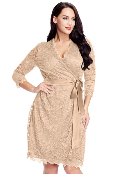 Front view of model wearing plus size beige lace crop sleeves wrap dress