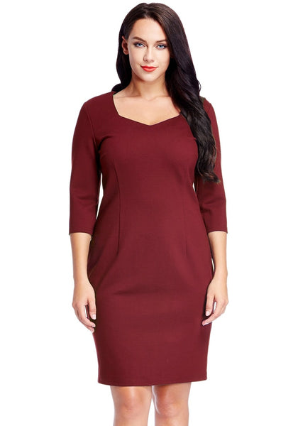 Front view of model wearing plus size burgundy decollete neckline pencil dress