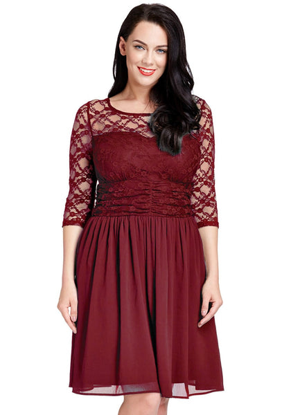 Front view of model wearing plus size burgundy lace crop-sleeves skater dress