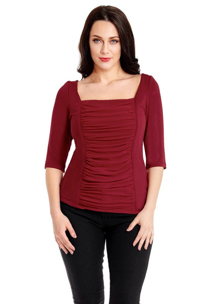 Front view of model wearing plus size burgundy square-neckline ruched mesh-front top