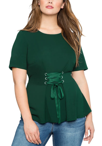 Front view of model wearing plus size dark green lace-up waist blouse