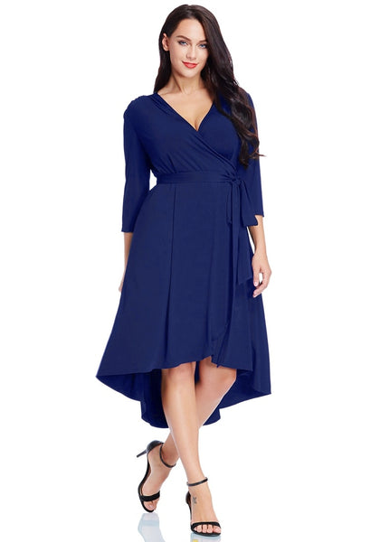 Front view of model wearing plus size royal blue high-low wrap skater dress