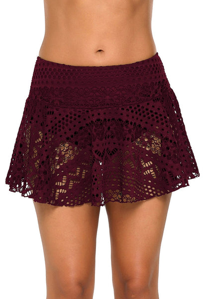 Front view of model wearing port lace crochet swim skirt