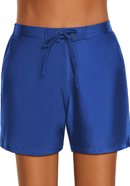 Front view of model wearing royal blue lace-up board shorts