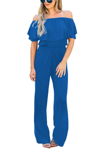 Front view of model wearing royal blue ruffled off-shoulder jumpsuit