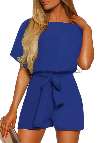 Front view of model wearing royal blue short sleeves keyhole-back belted romper