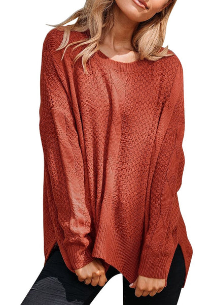 Front view of model wearing rust red ribbed knit textured side-slit sweater