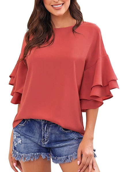 Front view of model wearing rust red trumpet sleeves keyhole-back blouse