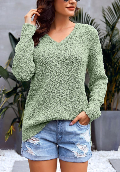 Front view of model wearing sage green V-neckline popcorn fuzzy fleece pullover sweater