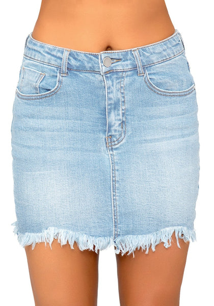 Front view of model wearing sky blue frayed hem washed denim mini skirt