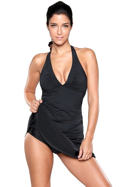 Front view of model wearing solid black flared swim skirt