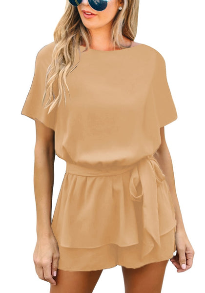 Front view of model wearing tan short sleeves keyhole-back belted romper