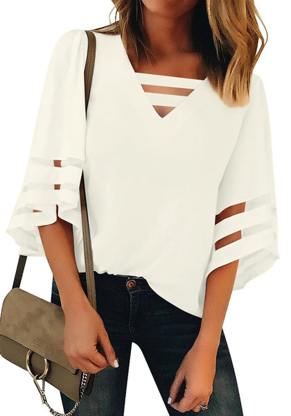 Front view of model wearing white 34 bell mesh panel sleeves strappy V-neckline loose top