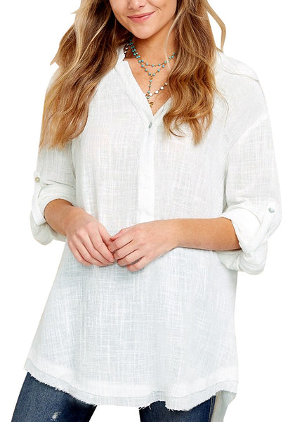 Front view of model wearing white  V-neckline roll-tab sleeves loose tunic top