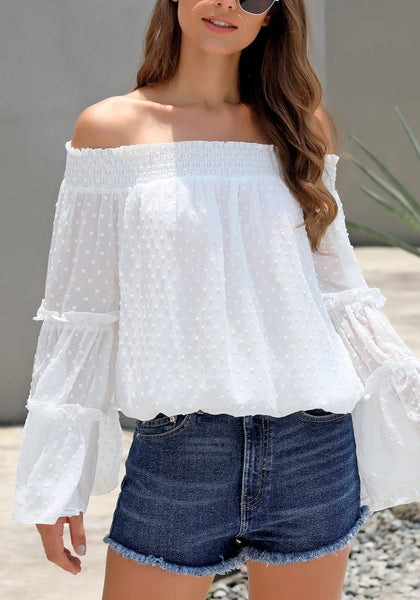 Front view of model wearing white bell sleeves dotted loose off-shoulder top