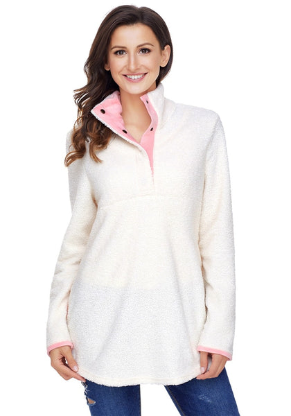 Front view of model wearing white button-front fleece pullover