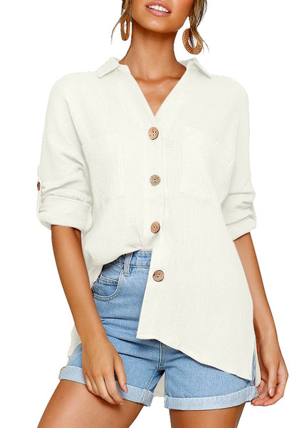 Front view of model wearing white collared V-neckline cuffed sleeves button-up top