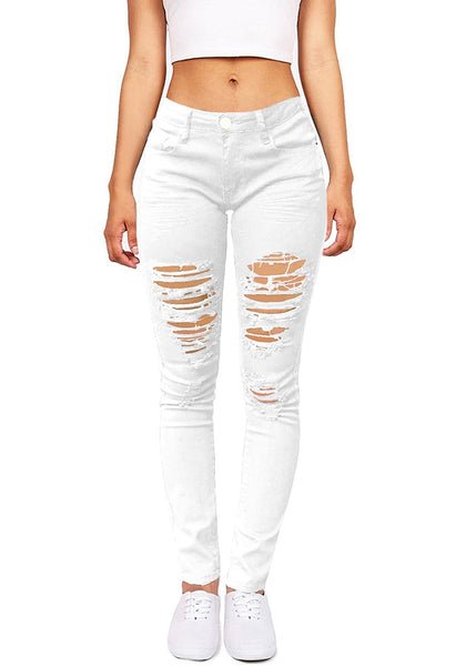 Front view of model wearing white distressed skinny jeans
