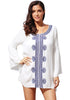 Front view of model wearing white embroidered bell sleeves beach cover-up
