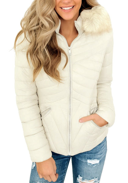 Front view of model wearing white faux-fur hood zip-up quilted jacket