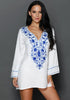 Front view of model wearing white floral embroidered v neck beach cover-up
