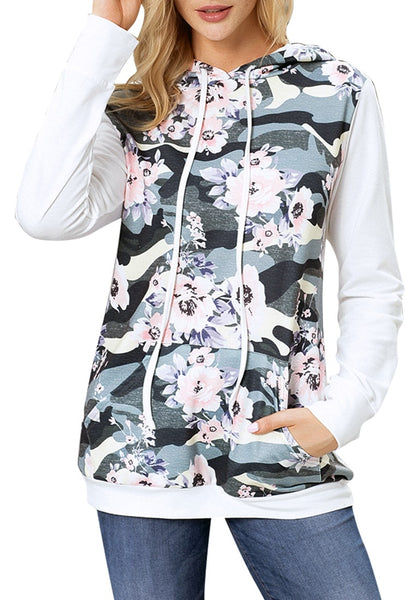 Front view of model wearing white floral long sleeves pocket pullover hoodie