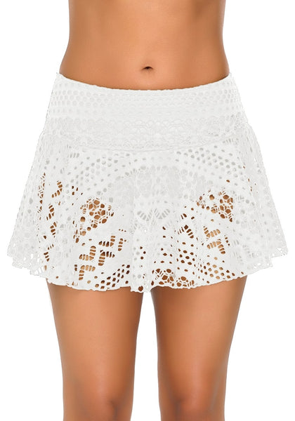 Front view of model wearing white lace crochet swim skirt