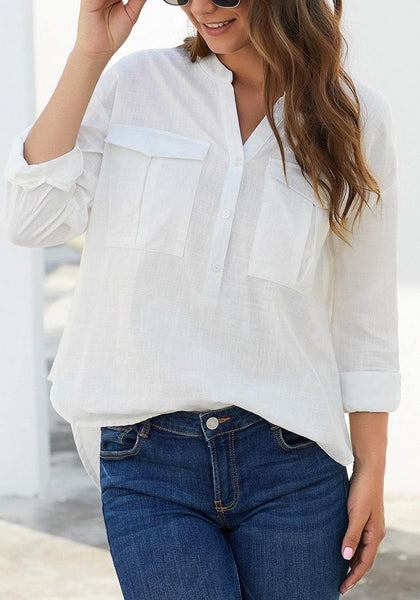 Front view of model wearing white notched henley cuffed sleeves blouse