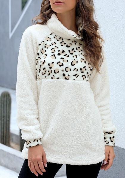 Front view of model wearing white oblique stand collar leopard fleece pullover