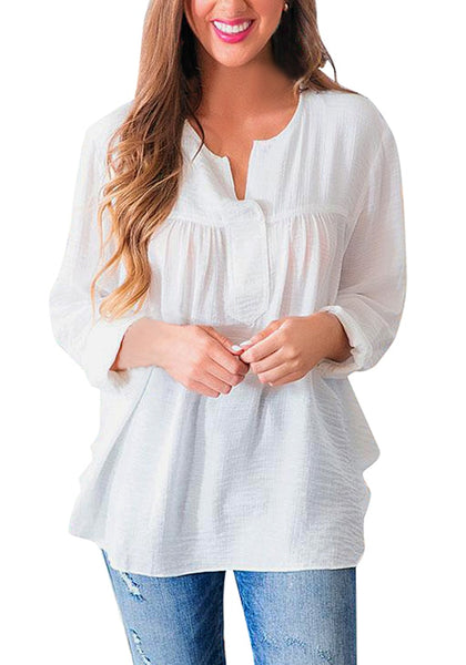 Front view of model wearing white slit V-neckline long sleeves flowy tunic top